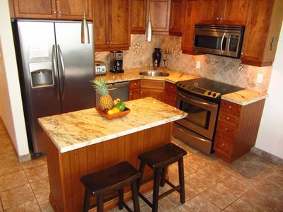 Fully equipped kitchen with maple cabinets, granite counters and all the gadgets