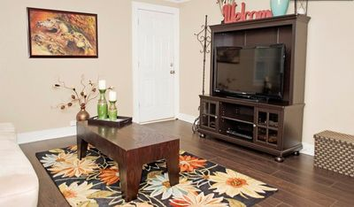 Large living room with flat screen cable TV and DVD player