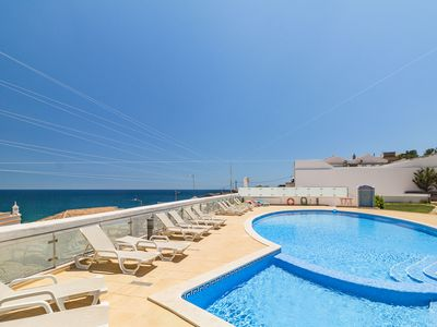 Photo for Cliff-side Apartment | Amazing ocean views | 3 Min walk from Carvoeiro beach