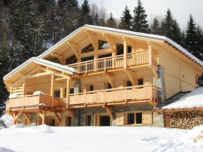 Photo for Chalet 320 m2 - 7 bedrooms, ski slopes and ski lifts - up to 24 people