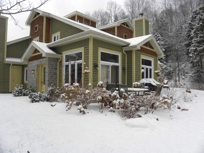 Condo in winter showing patio and bbq