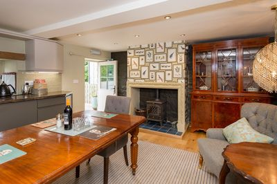 The Coach House Kitchen/Dining Room with log fire for cosy evenings
