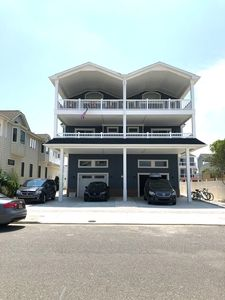 Photo for A block and a half from the beach & near restaurants.  View of the Bay & Ocean from both front decks