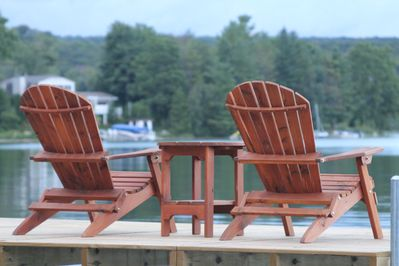 Adirondack chairs set on the dock awaiting you and your morning coffee.