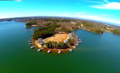 Photo for Lake front home on wide open Cove, deep water access and minutes to marina