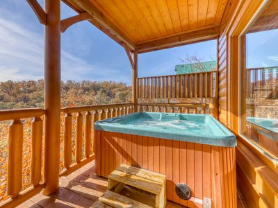 Photo for Log cabin w/ a private hot tub & amazing mountain views