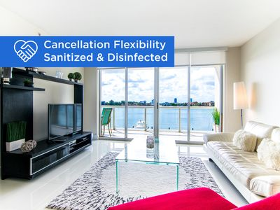 Photo for Spacious and modern condo with bay views. 1/2 mile from the beach! WiFi