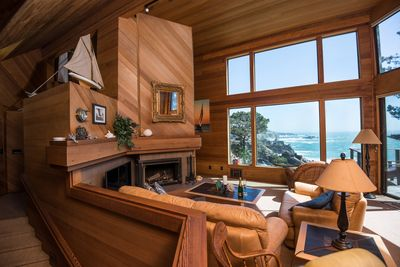 Living room, fireplace, leather sofas, game table and forever views