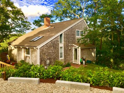 The house combines Mid-Century Modern + classic Cape Cod architectural elements.