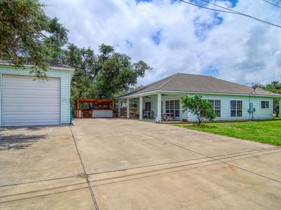 Photo for NEW LISTING! Cozy Coastal home w/covered porch and boat parking - dogs ok!