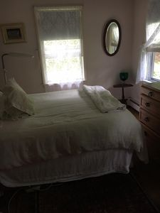 Main bedroom. Pillow-top queen mattress and cotton white sheets/comforter.
