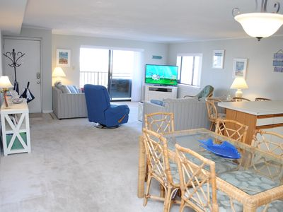 Photo for Spacious 3-bedroom condo with free WiFi and a partial ocean view located midtown and just a block from the beach!