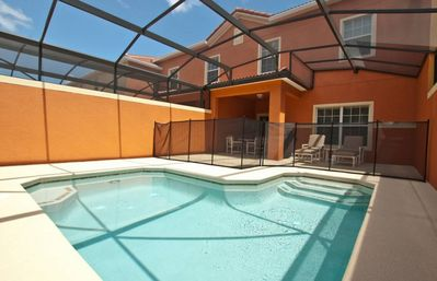 Photo for SOUTH FACING POOL, BBQ GRILL, GATED RESORT COMMUNITY, BEAUTIFULLY DECORATED!