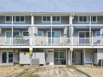 Photo for FREE DAILY ACTIVITIES!!! OCEANSIDE!  Wonderful bright & pretty 3 bedroom, 3 bath townhouse is the perfect place to drop your bags and walk to the beach!!