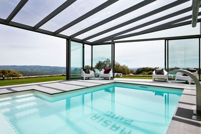 Private indoor/outdoor pool with hill views
