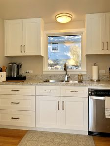 New kitchen with SS appliances and a dishwasher. Well stocked cabinets..