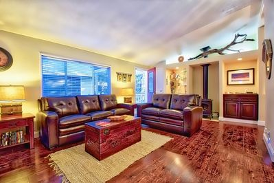 Cozy and comfortable seating in the living room with propane fireplace