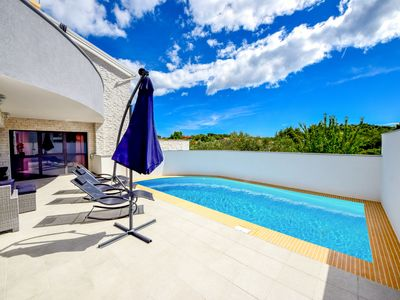 Photo for This 4-bedroom villa for up to 10 guests is located in Vodice and has a private swimming pool, air-c