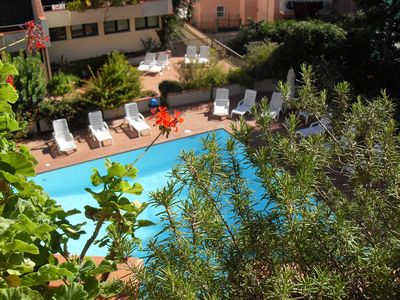 Photo for Central Holiday Apartment with Balcony & Pool; Parking Available, Pets Allowed