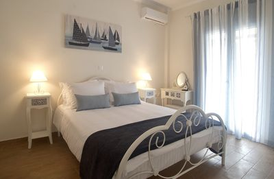 Photo for The Bluehouse - Spacious top floor flat with parking, by Mon Repos beach