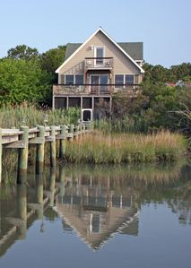 House from water, screeded porch, large deck, balcony and private dock.