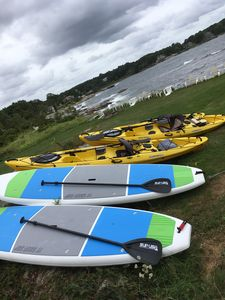 FREE TOP OF THE LINE PADDLEBOARDS AND KAYAKS FOR YOUR USE .FISHING POLES TOO