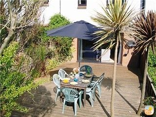 Photo for Quality Home on the Beach in unspoilt Seaside Village just 50 m from the Sea