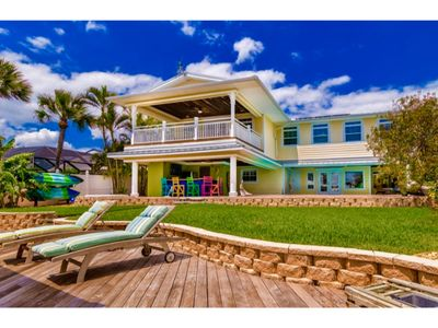 Photo for Private Beachside Riverfront Resort! Heated Pool, Spa, Game room, tiki bar, dock