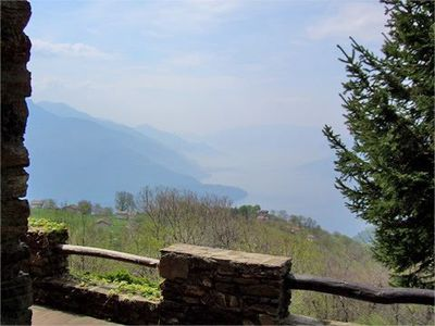 Photo for Holiday home Casa Balbi is on a sunny terrace  high above Lake Como with breathtaking panoramic view