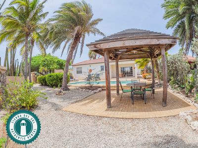 sit under the backyard gazebo while relaxing with the soothing Aruban breezes.