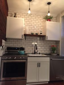 Brand new kitchen with full size appliance and high end finshes