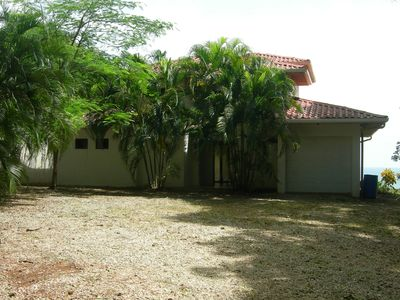 Front of the house with grown trees