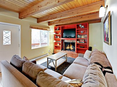 """Living Room - Welcome to Vail! Your rental is professionally managed by TurnKey Vacation Rentals. Sprawl out on the sectional sleeper sofa and watch shows on the 36"""" TV."""