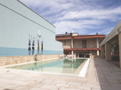 Photo for Apartotto - Apartment in the city with swimming pool