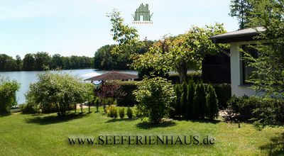 Photo for Dream holiday home on Lake Schwerin ✓ Pet & fishing on a private beach ✓