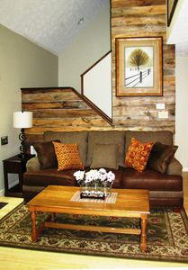 custom barn wood living room wall brings the outdoors in with its natural colors