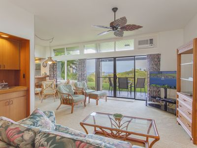Photo for A large lawn area provides additional outdoor living space in this beautiful ocean view villa