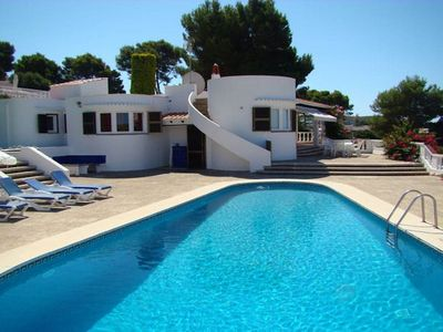 Photo for Spacious, mature and built on once level with four double bedrooms, three bathrooms, a super poolsid