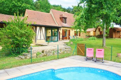 swimming pool, garden and house