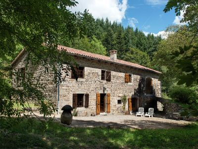 Photo for Beautiful stone farmhouse in mountain forest setting