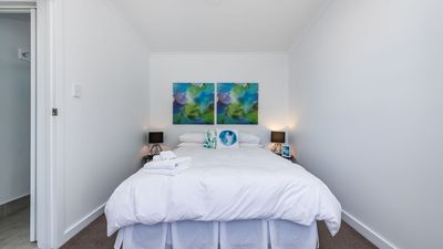 Main bedroom with Queen bed, all linen is of beautiful quality, is crisp & white