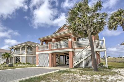 This handsome beach house offers a great location in the Fort Morgan area.