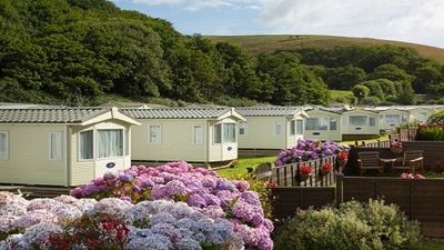 Photo for Holiday caravan on quiet beach side park in South Devon, heated indoor pool.