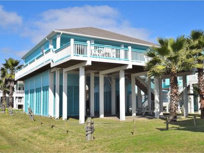 Photo for The beach is just a short walk away from this stunning home.