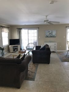 Living room w/ceiling fan, cable Flat screen TV, queen sofa bed.