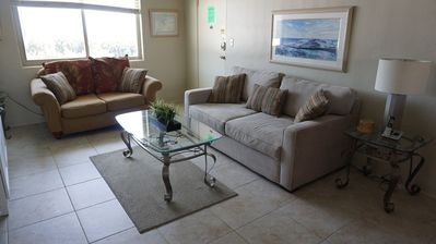 Photo for Gulf views out the front window, few steps to the beach, 2BR poolside condo!