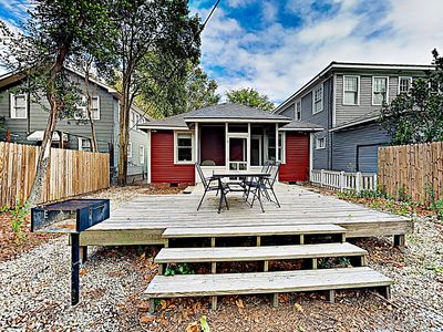 Deck - Share alfresco meals on the back deck, where there's seating for 3 and a charcoal grill.