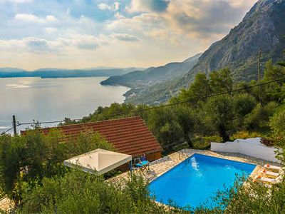 Photo for 3 bedrooms, stunning mountain and sea views, private pool, located a stones throw to Nissaki.