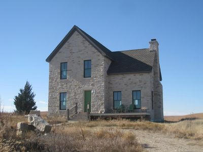 True Prairie Home, nestled in the Flint Hills, surrounded by a sea of grass.