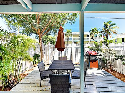 Courtyard  - Step into a fenced courtyard, complete with a patio dining set for 4.